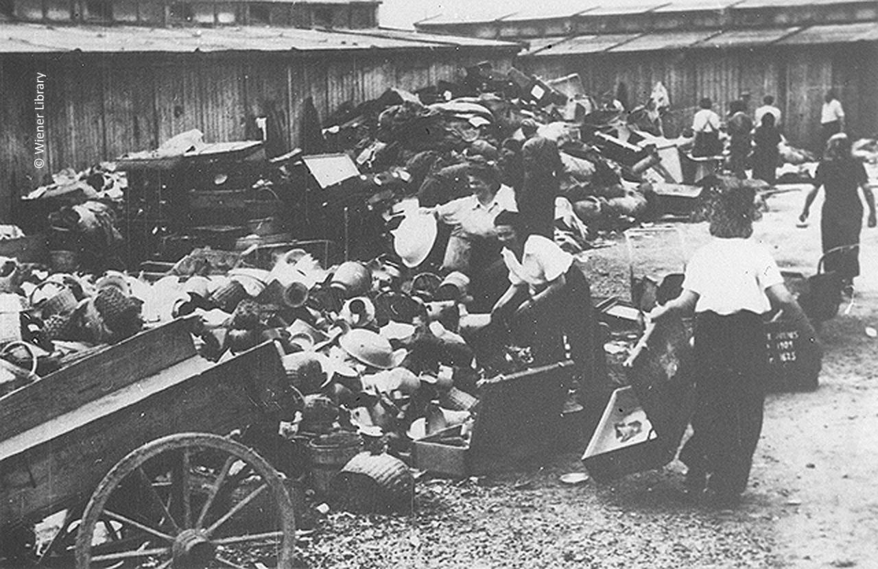 Female inmates sorting belongings of gassed Jews at the Kanada store in June 1944