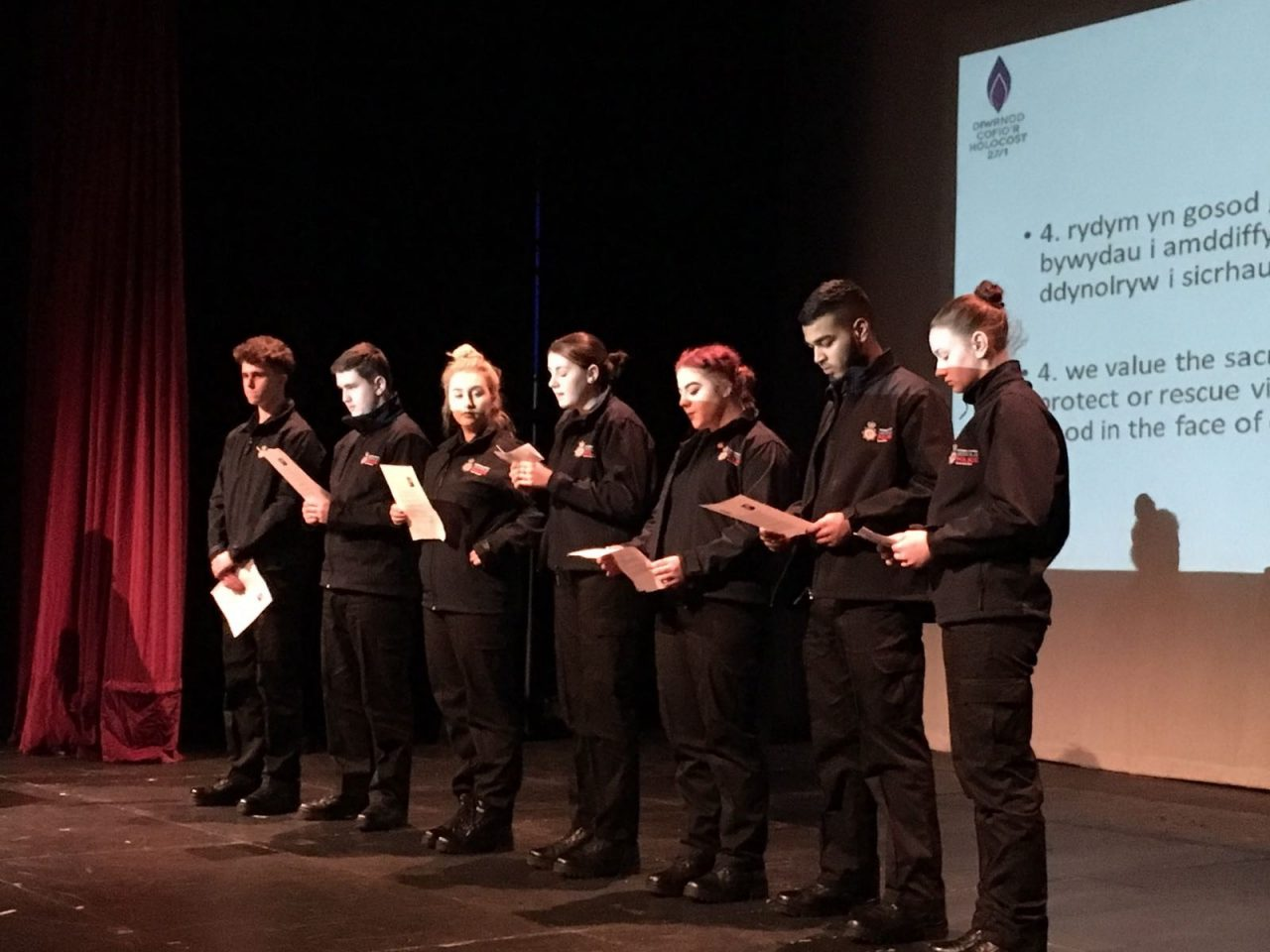 Police youth volunteers from South Wales Police sing and perform a song at their event to mark Holocaust Memorial Day