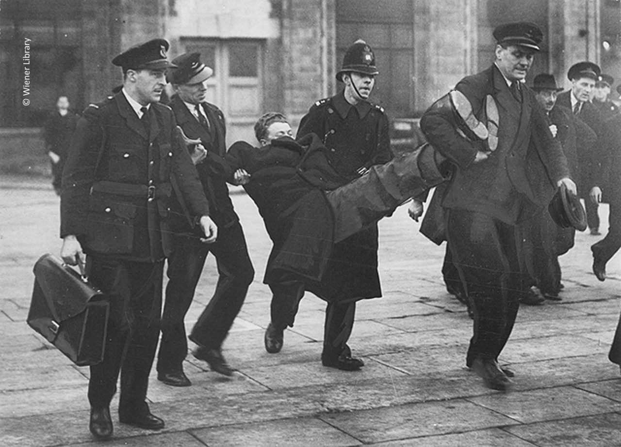 Refugee from Czechoslovakia being removed from Croydon Airport