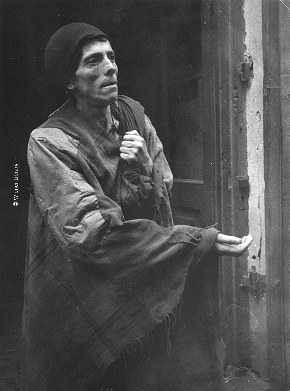 Man begging in the Warsaw Ghetto, 1941