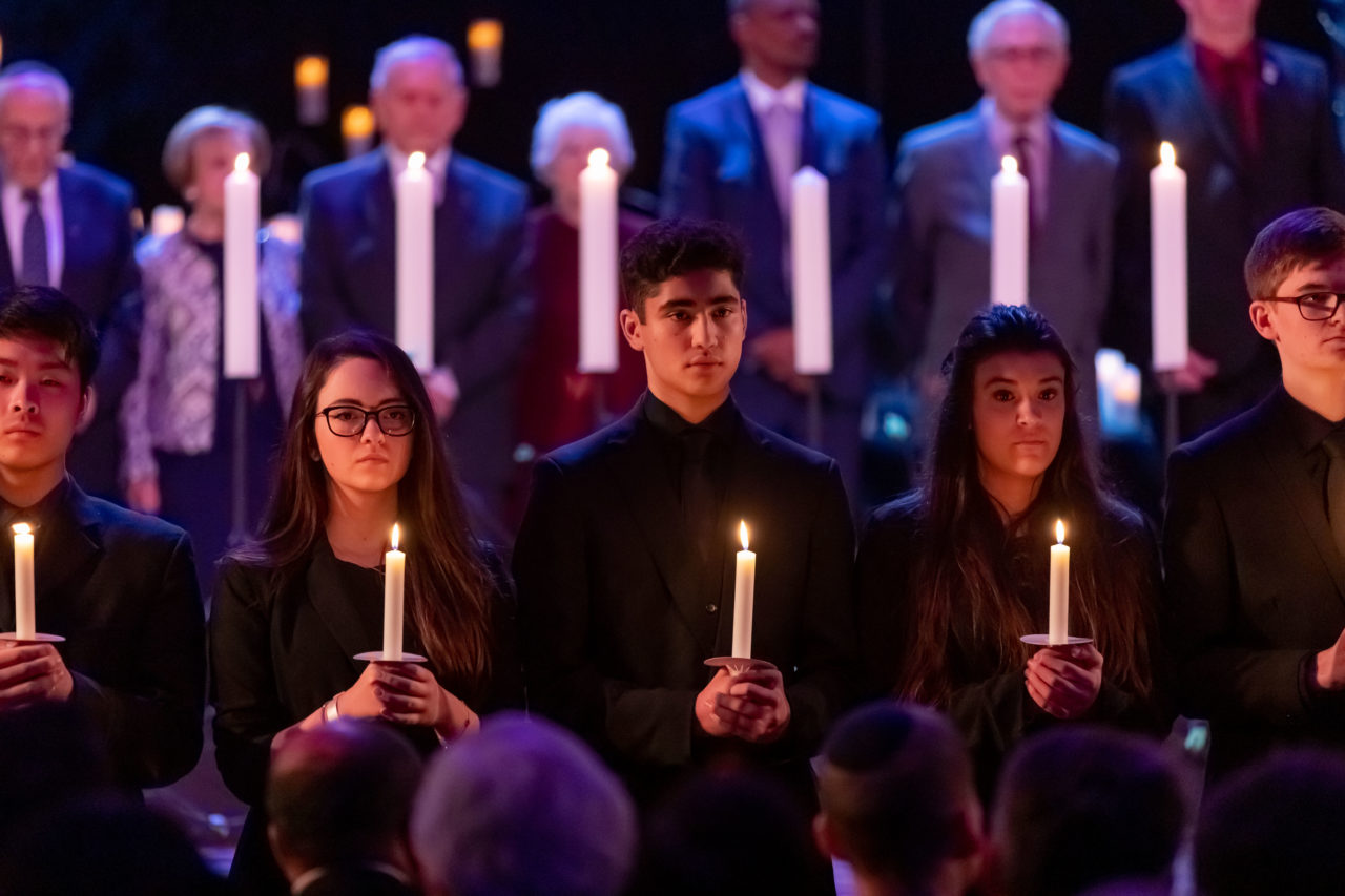 Students from Coopers School light candles of remembrance