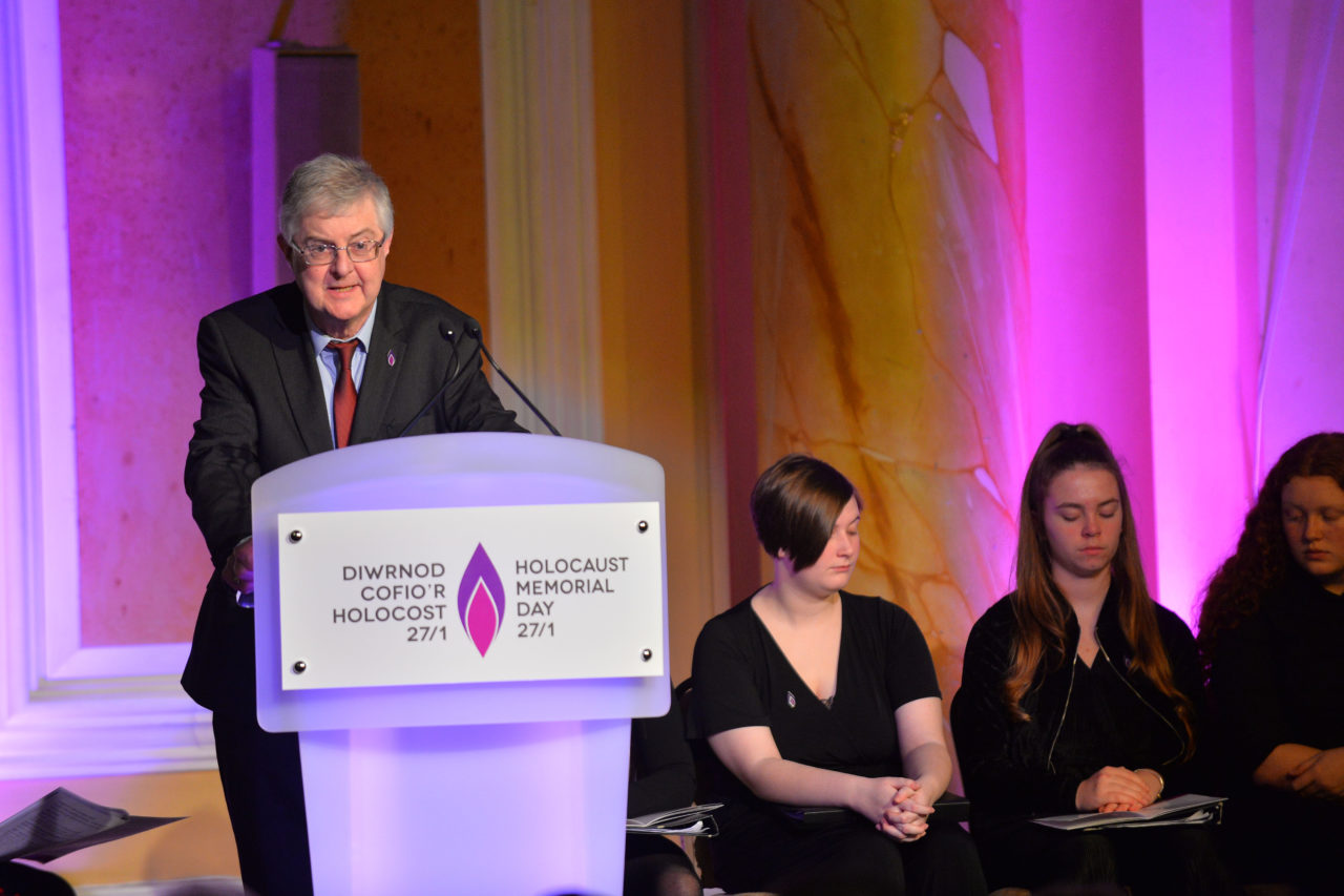 The Rt. Hon. Mark Drakeford AM, The First Minister of Wales, reads 'Belsen Silence' by Iolo Lewis. © Welsh Government (Crown Copyright), all rights reserved